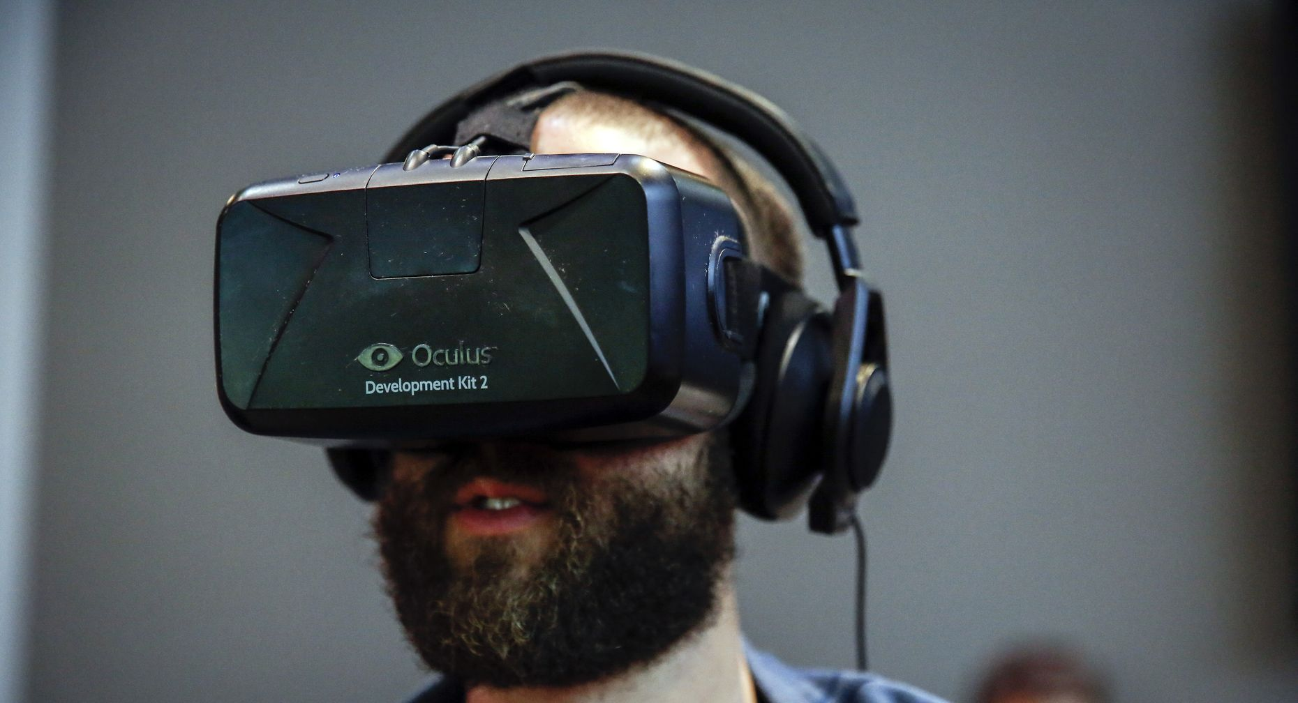 A user trying the Oculus Rift developer kit headset. Photo by Bloomberg.