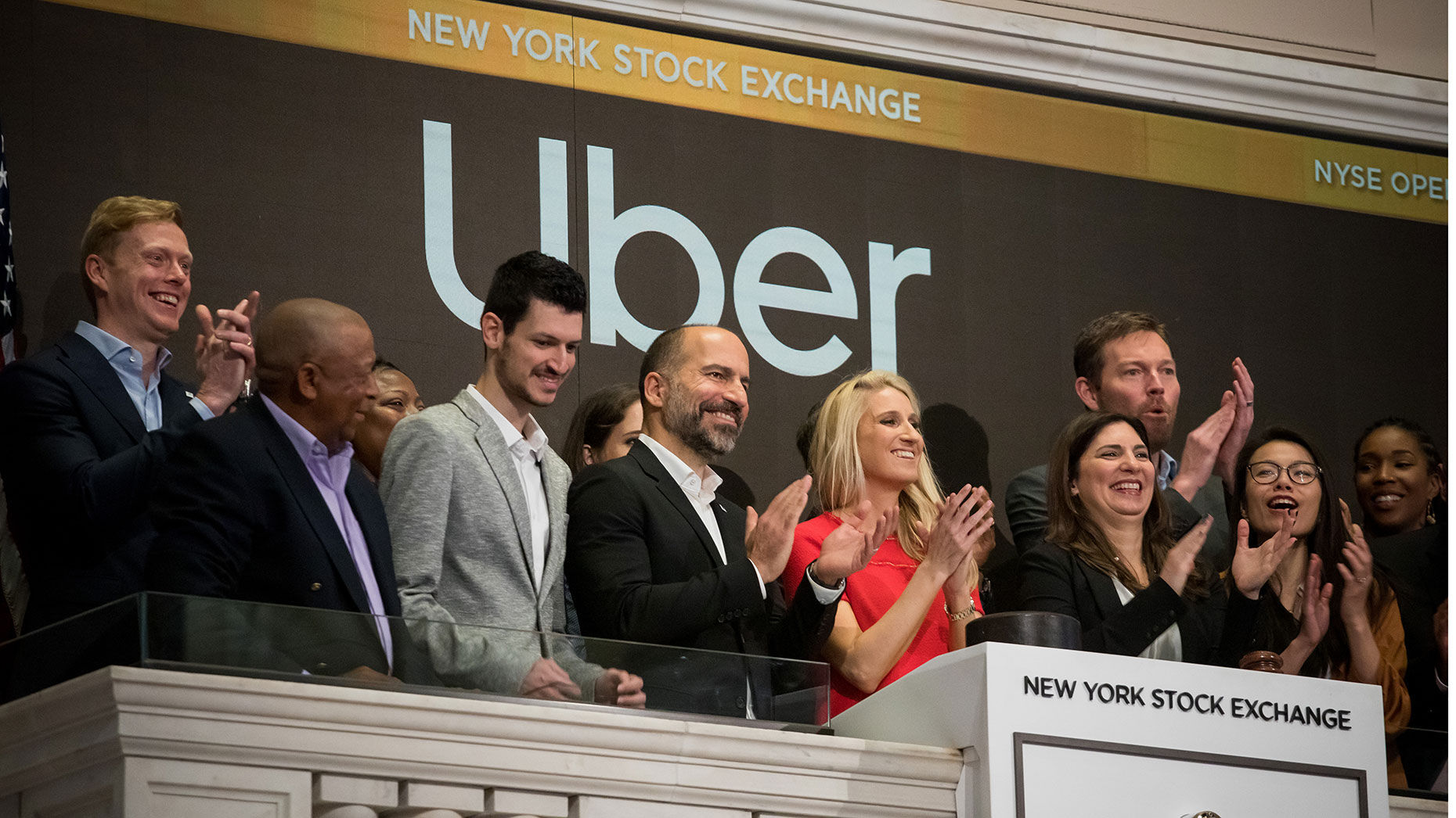 Uber CEO Dara Khosrowshahi (center) with early Uber employee Austin Geidt (wearing red) and other Uber employees and drivers. Photo by Bloomberg.