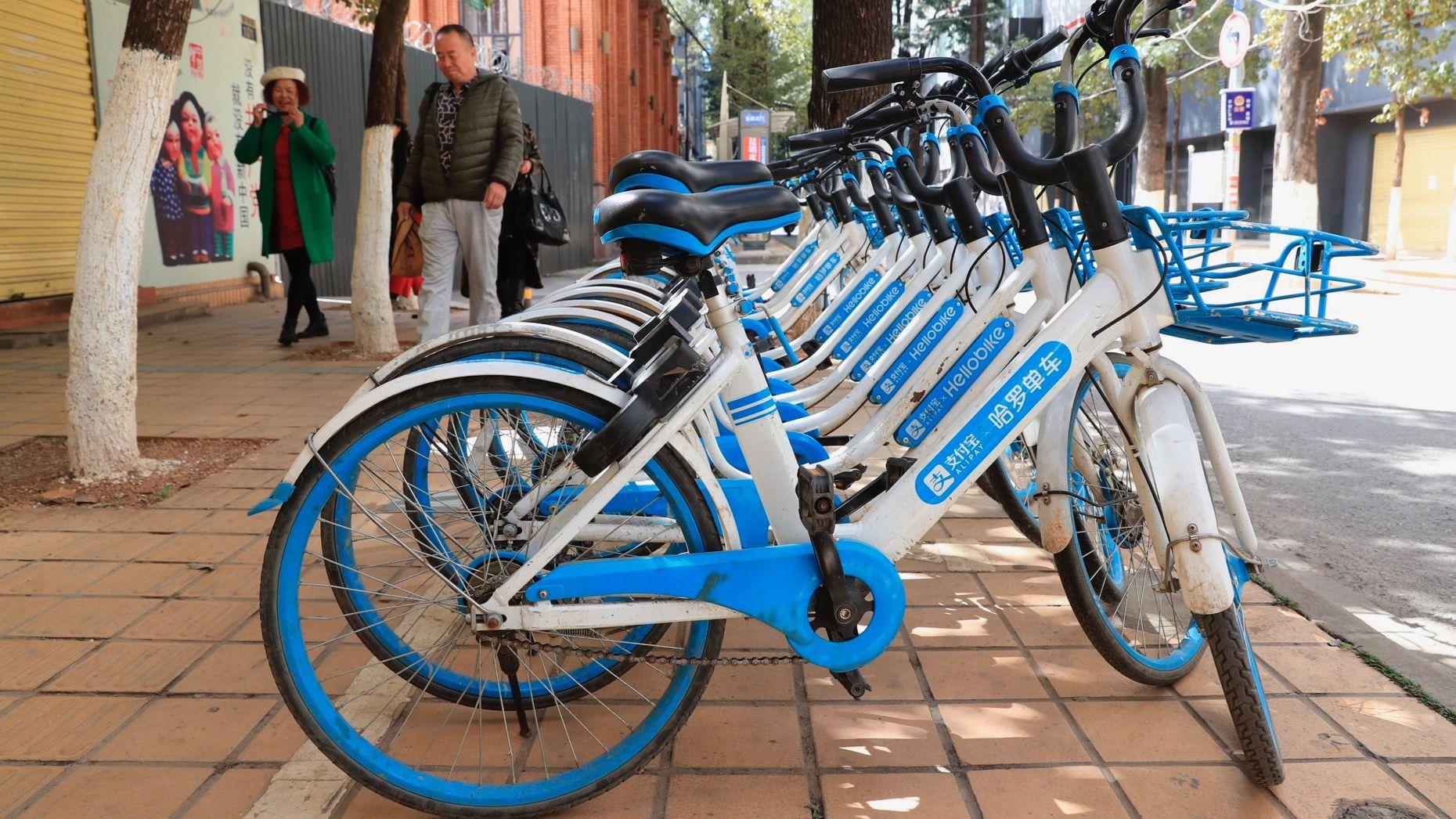 Hellobike bikes parked on a sidewalk in Shanghai. Photo: AP