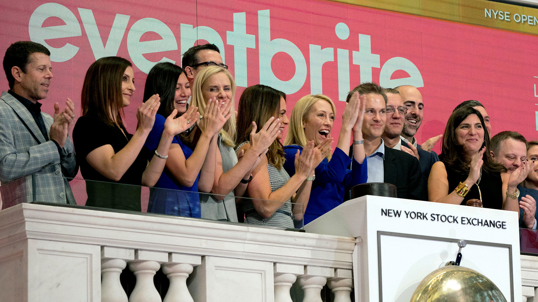 Eventbrite CEO Julia Hartz, center, and Kevin Hartz, right center, her husband and company chairman, celebrate as she rings the New York Stock Exchange opening bell, Thursday, Sept. 20, 2018, to mark the company's IPO. Photo by AP.