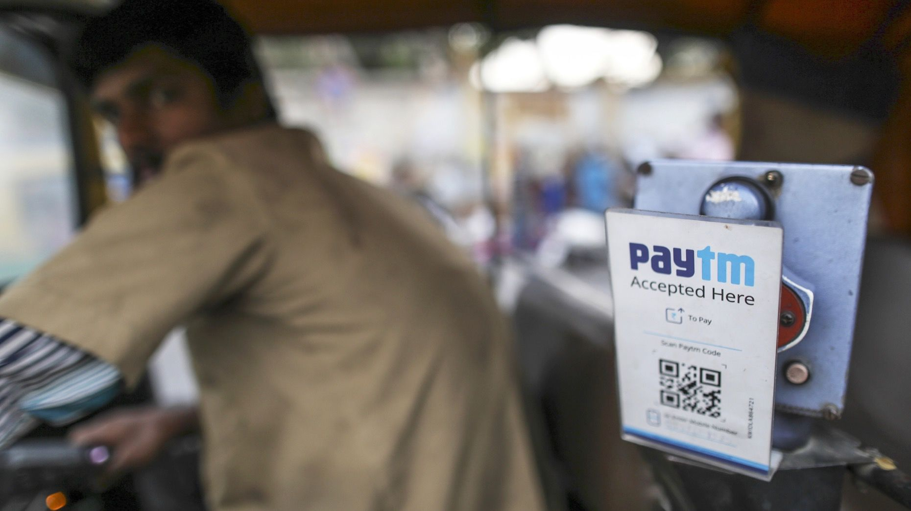 A driver in Bengaluru, India, who accepts Paytm. Photo by Bloomberg.