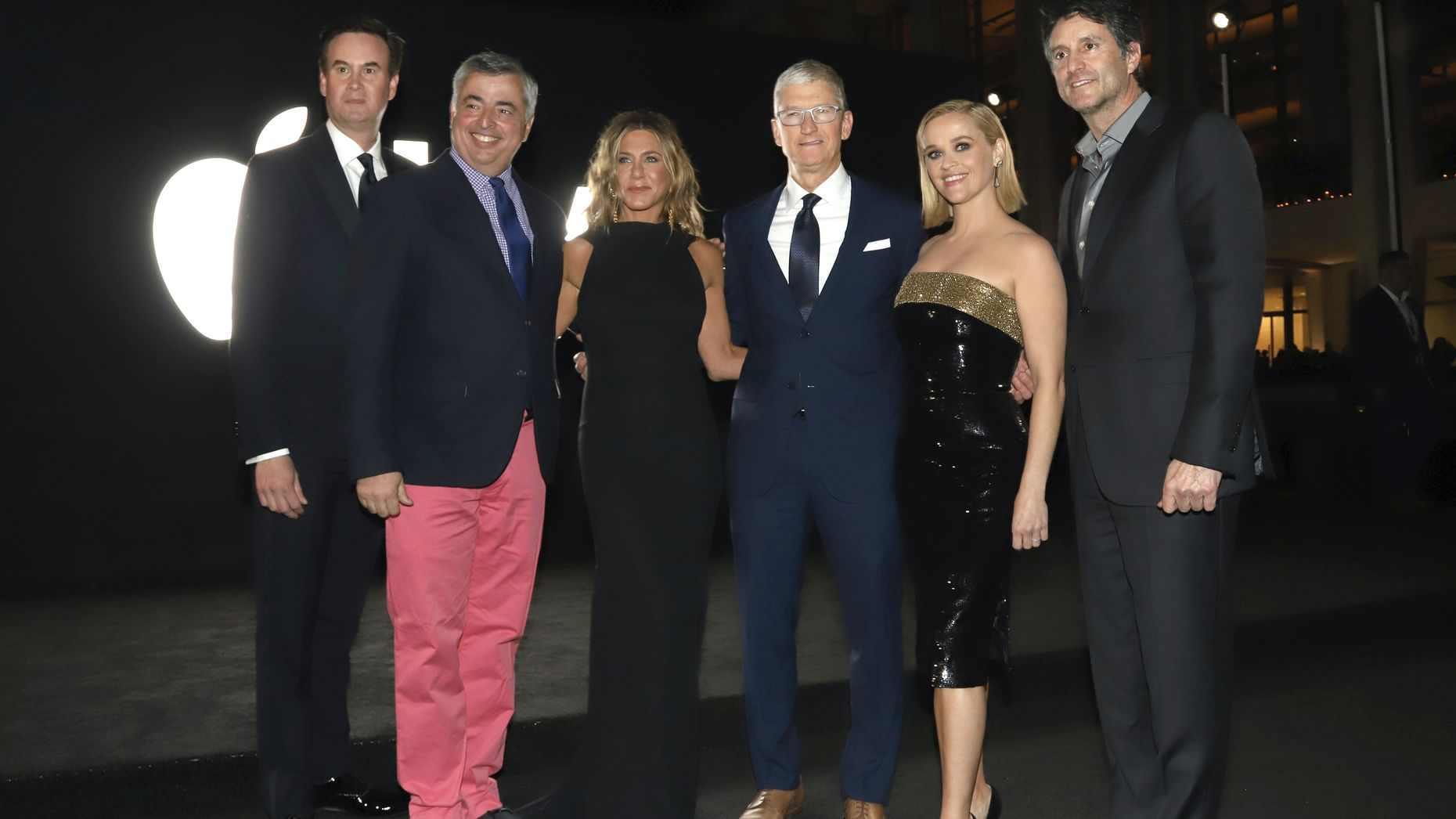 Apple's Zack Van Amburg, Eddy Cue (in red pants) with Jennifer Aniston, Apple CEO Tim Cook, Reese Witherspoon and Apple's Jamie Erlicht