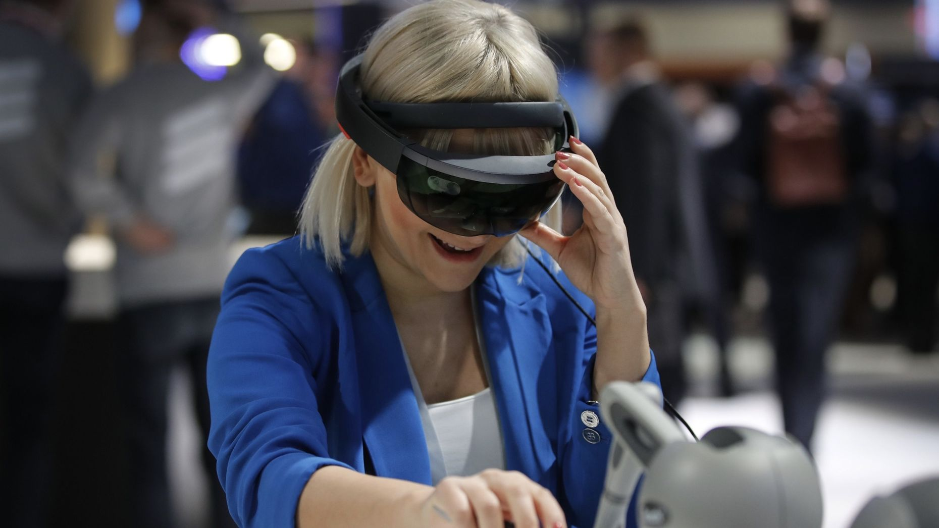 An attendee at Mobile World Congress in Barcelona this year wearing a Microsoft Hololens AR headset. Photo by Bloomberg