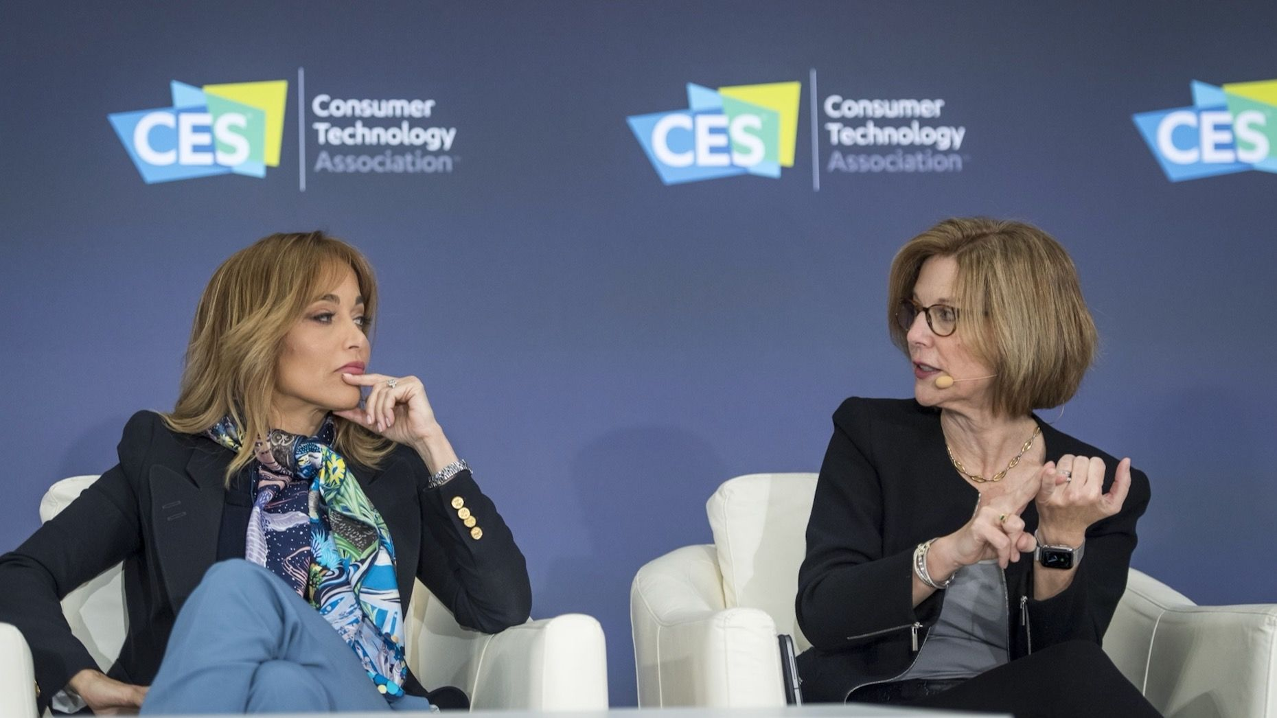 Erin Egan, chief privacy officer at Facebook, left, listens as Jane Horvath, senior director of global privacy at Apple, speaks during a panel discussion at CES. Photo by Bloomberg.