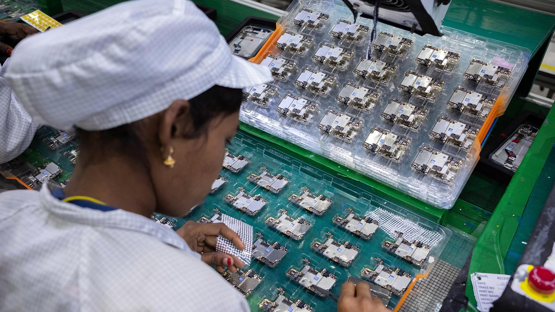 An employee at a Foxconn factory in India. Photo by Bloomberg.
