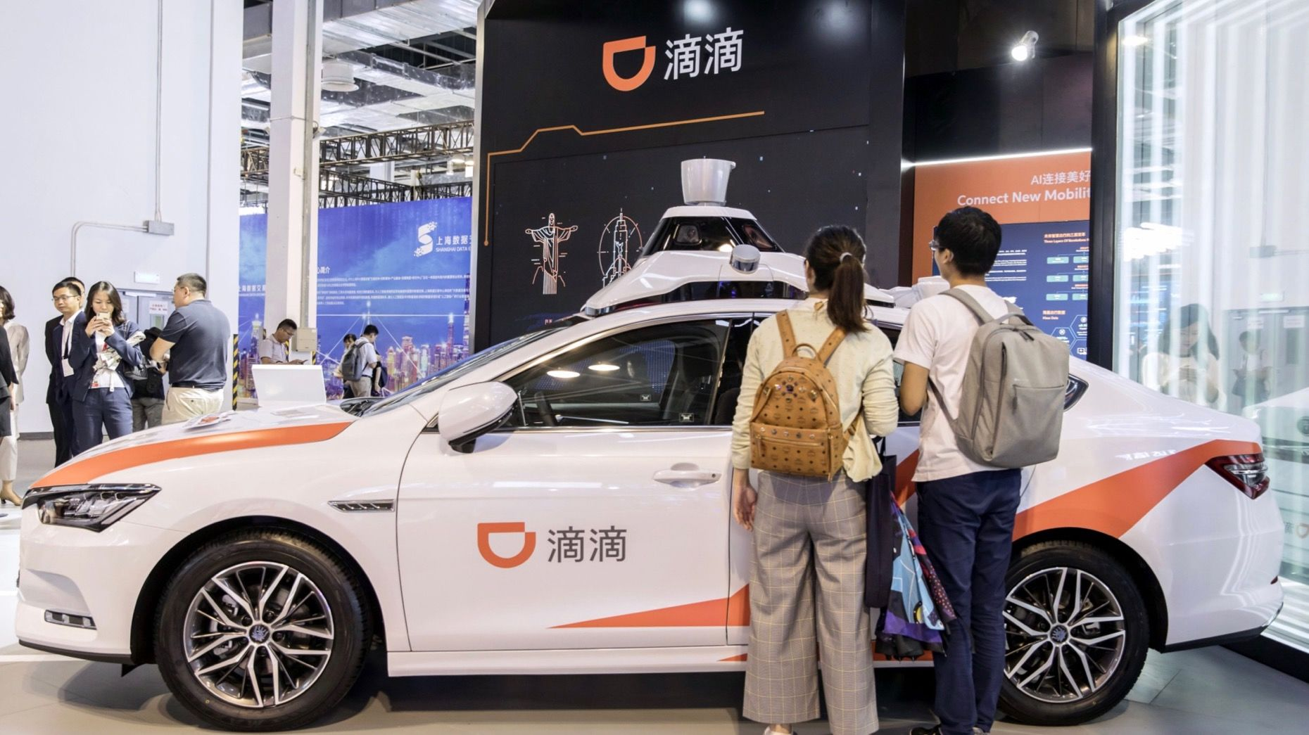 Attendees looked at a Didi autonomous vehicle at the World Artificial Intelligence Conference in Shanghai in August. Photo: Bloomberg