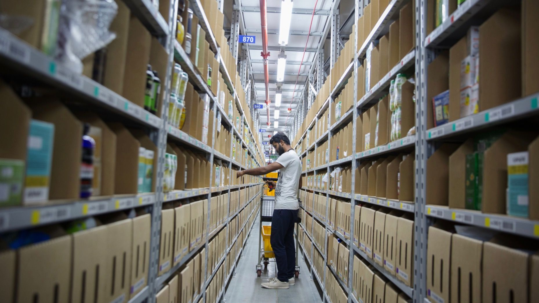 An employee worked at an Amazon warehouse in Bangalore, India, in 2018. Photo: Bloomberg