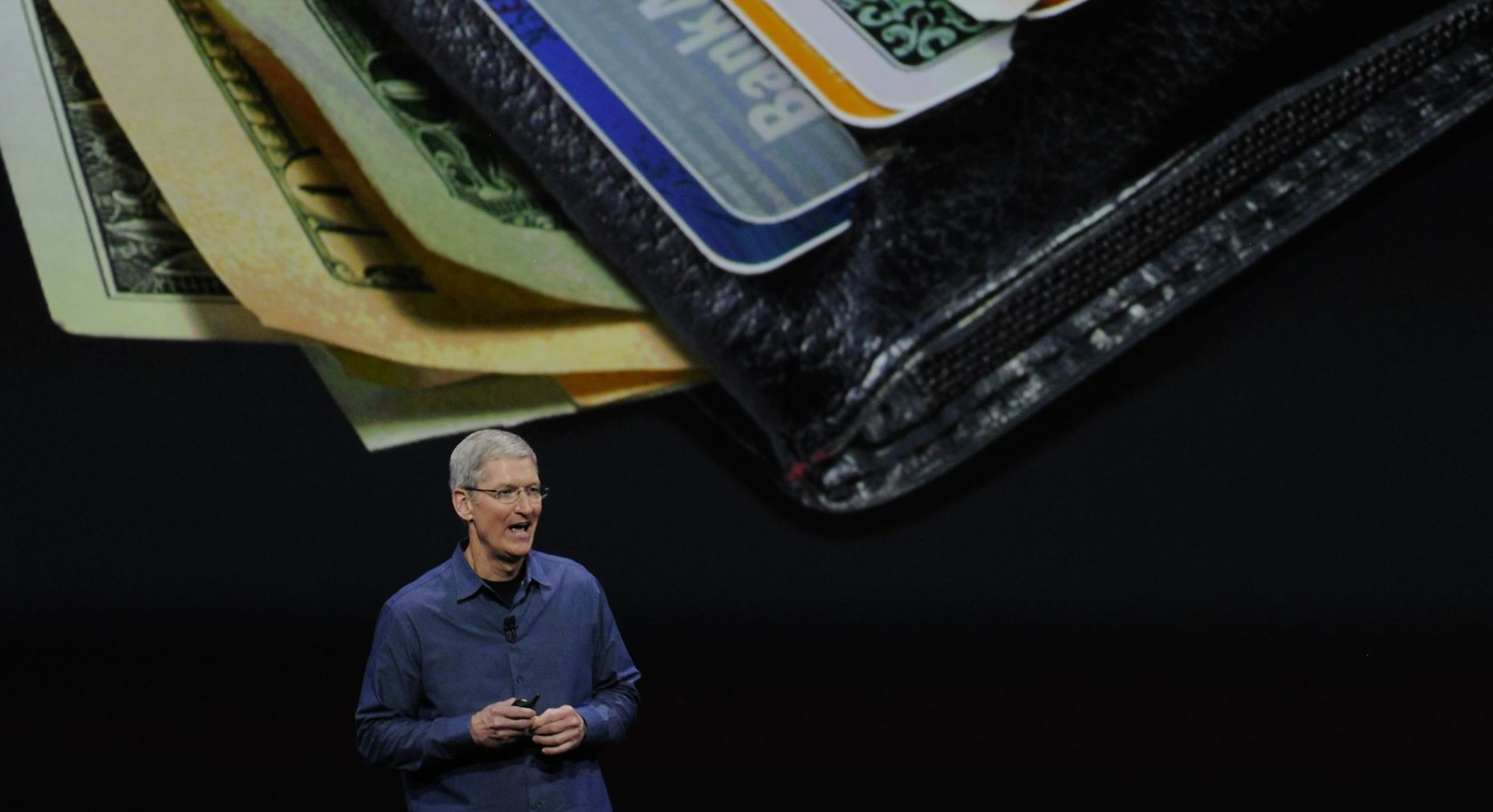 Apple CEO Tim Cook announcing Apple Pay. Photo by Bloomberg.