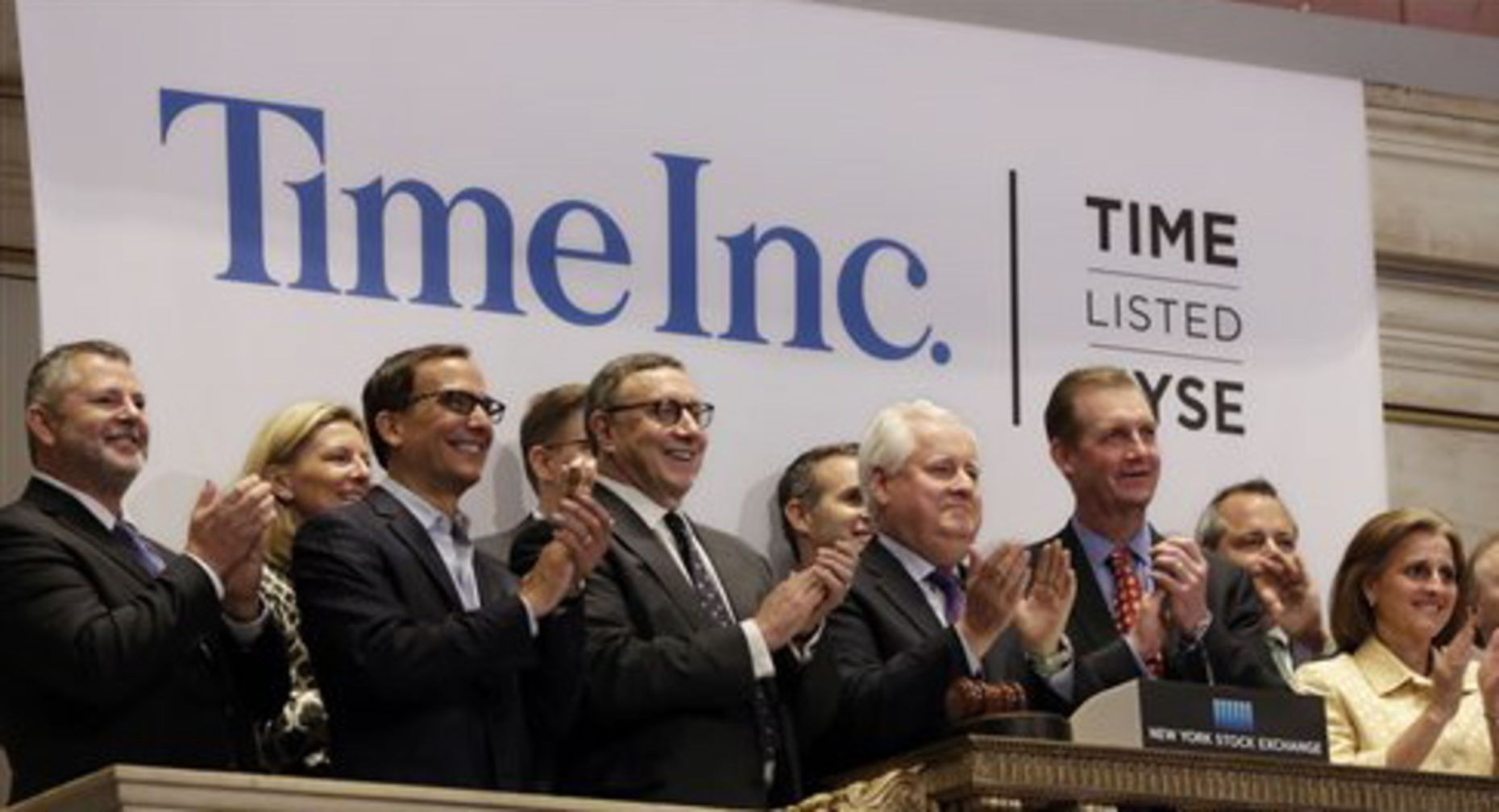 Time executives on the company's first day of trading this year. Photo by Associated Press.