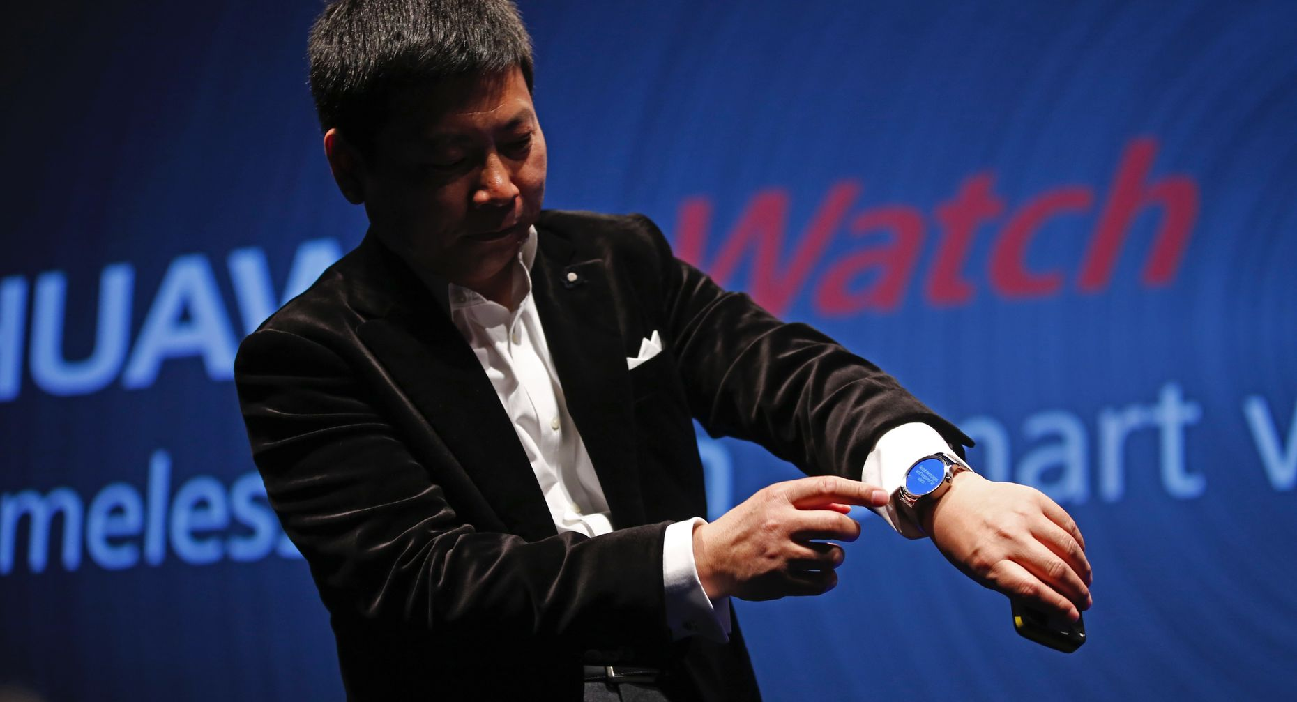 Huawei device group head Richard Yu with the smartwatch. Photo by Bloomberg.