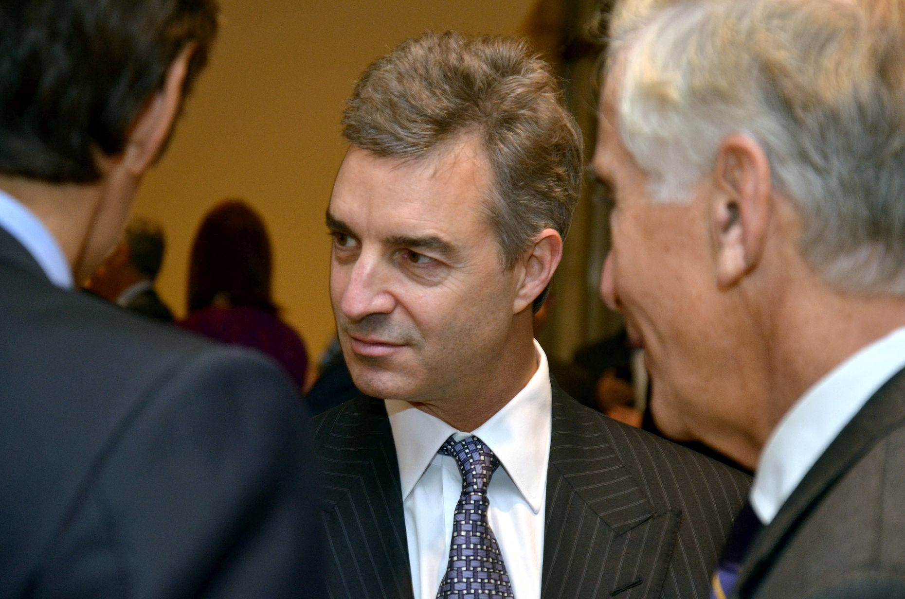 Dan Loeb, center, of Third Point. Photo by Bloomberg.